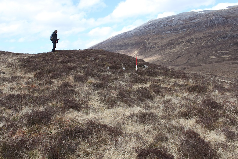 Kirsty Millican surveying on a desolate moorland