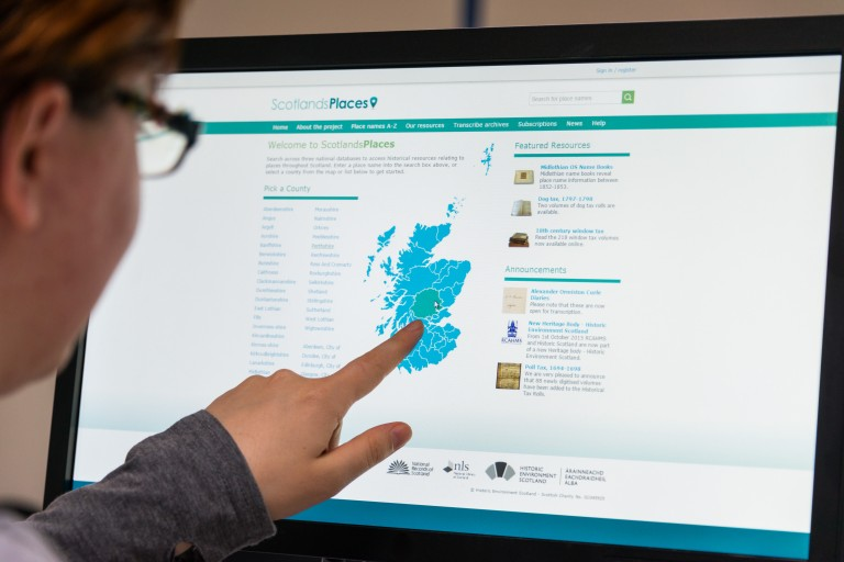 A photo showing the Scotland's Places website on a P{C screen