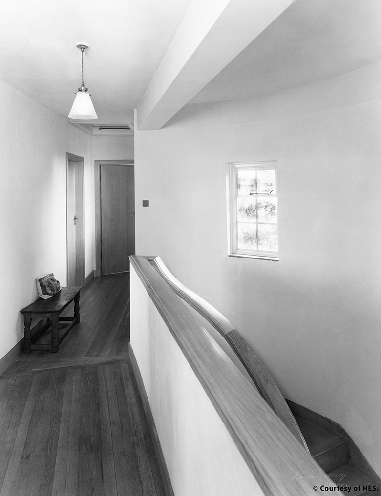 black and white photo of a hall and landing