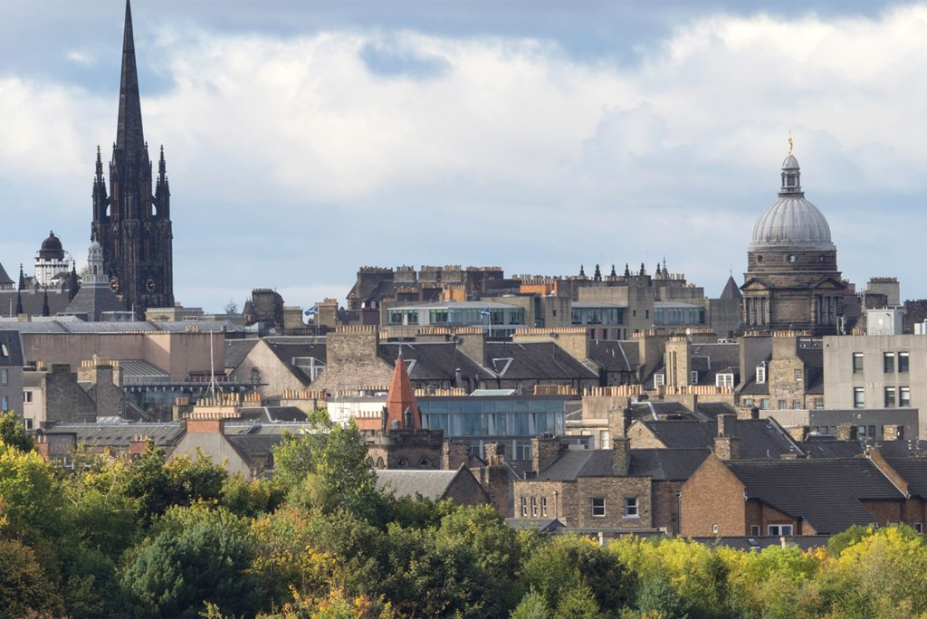 Edinburgh skyline featuring the spire of The Hub and the dome of Edinburgh's Old College