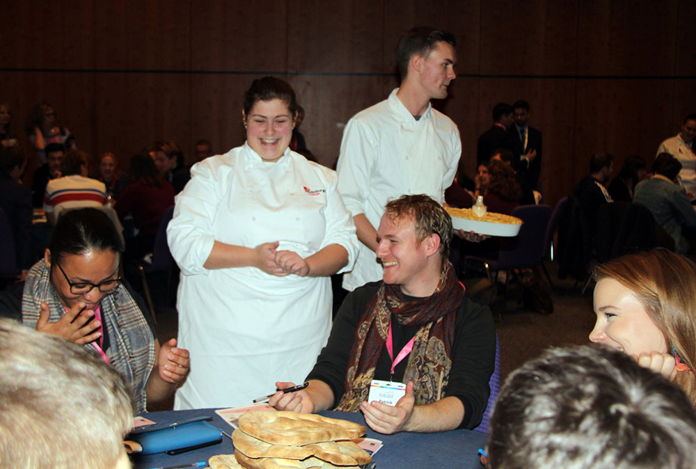 Two students from Edinburgh College showcase bread and a pie they have made at an event.