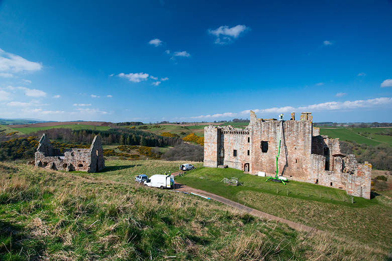 Panoramice view of Crichton Castle which shows a white van in front of it