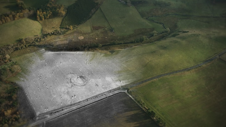 A aerial photo of farmland layered with a computer generated re-imagining of a Pictish site