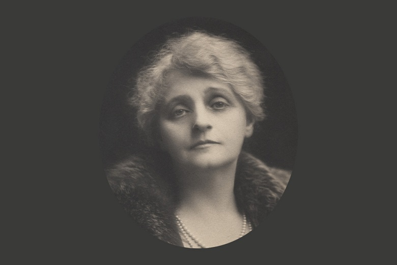 A portrait photo of Lady Moir wearing a fur coat and pearl necklaces
