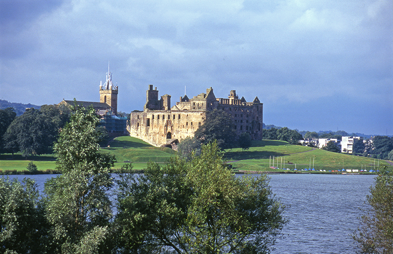 view of Linlithgow Palace from across the loch