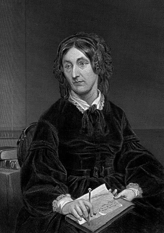 A black and white portrait of Mary Somerville sitting in a chair writing a letter