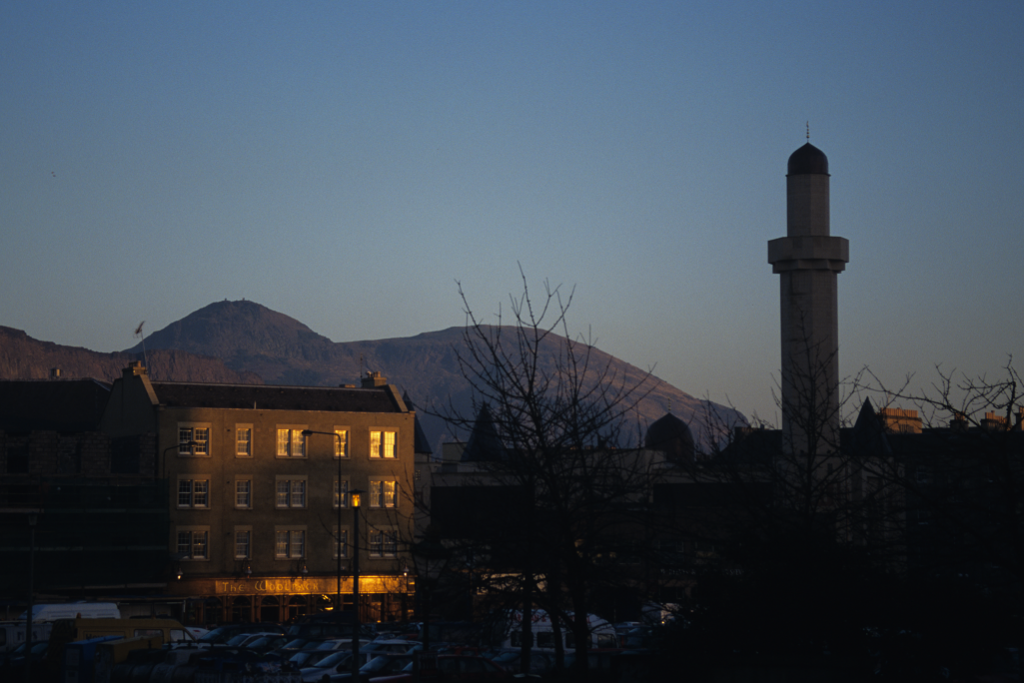 evening view of the Edinburgh skyline featuring the minaret of Edinburgh Central Mosque and Arthur's Seat
