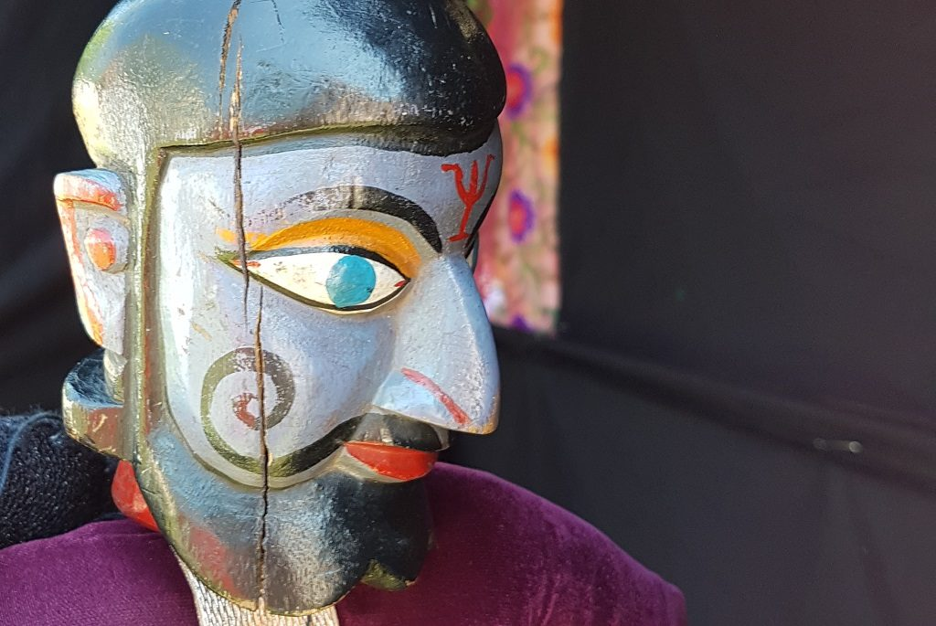 Image of painted puppet at the Mela