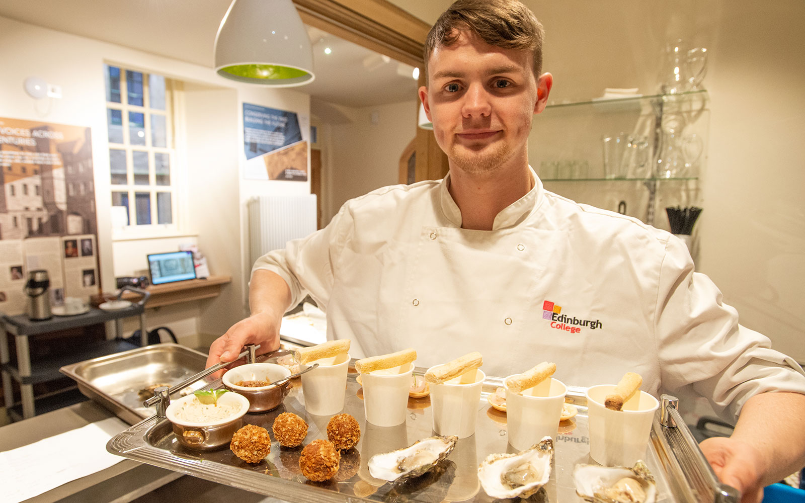 A Hospitality student from Edinburgh College shows off culinary creations based on medieval Scottish recipes