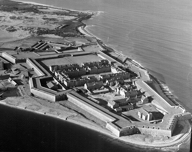 A black and white aerial shot of Fort George showing its position jutting into the Moray Firth, surrounded by water on three sides