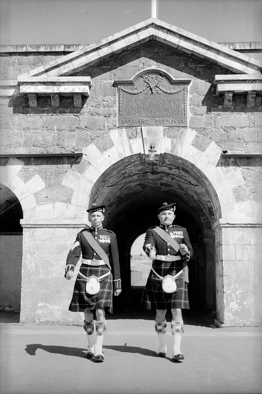Archive photo of two soldiers in kilts marching through Fort George
