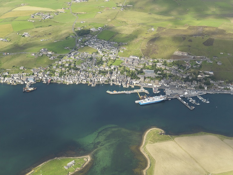 An aerial photo of Stromness showing a ferry arriving at the harbour