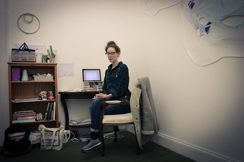 An artist working in an office at the Stromness studio space opened by Wasps