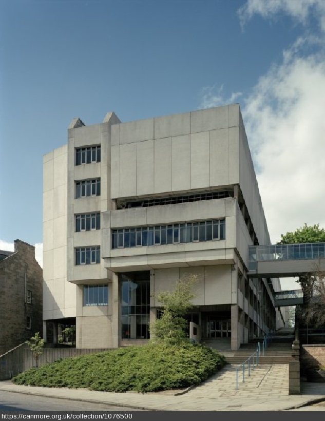 View of a concrete brutalist building with projecting planes and cut-away recesses
