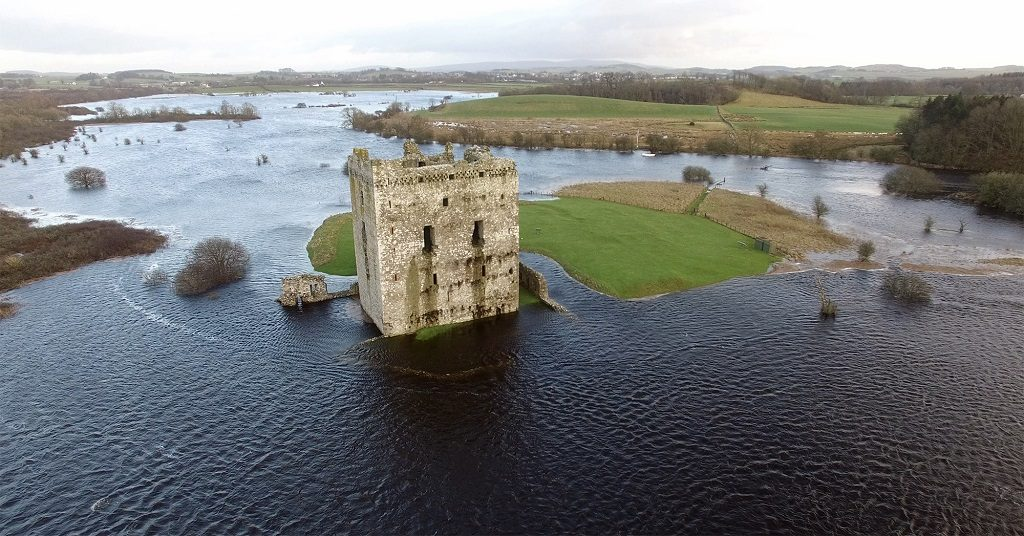 Threave Castle surrounded by floodwater