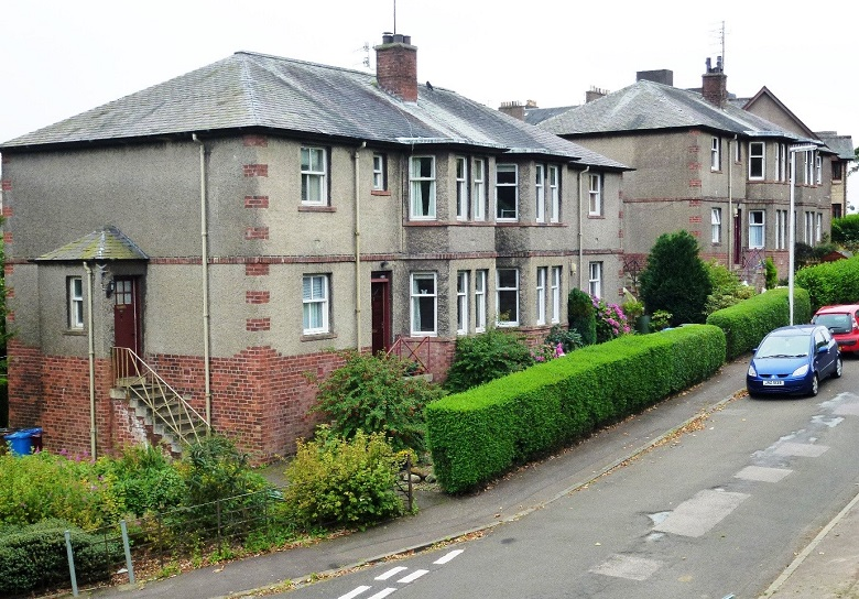 Photo showing typical brick-built and rendered 'four in a block' housing