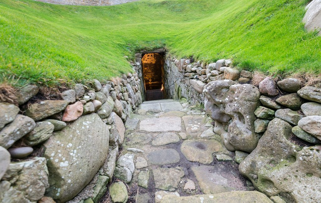 Steps leading into the grass-covered door of Burghead Well