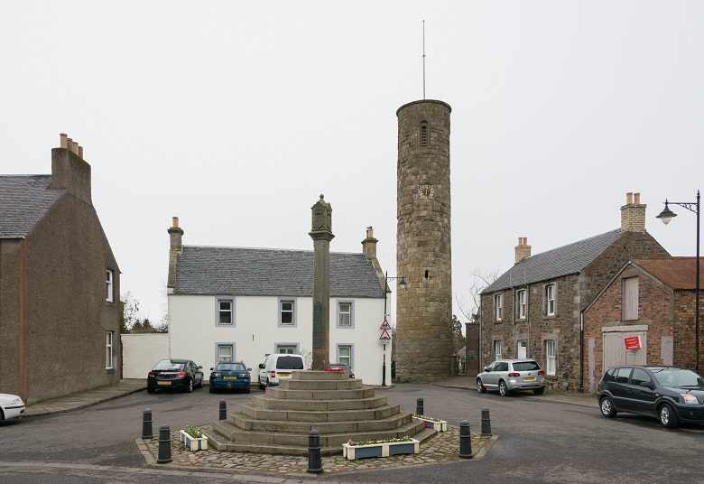 Abernethy Round Tower dominating Abernethy town centre with a war memorial in the foreground