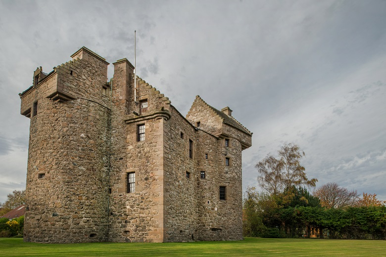 The exterior of Claypotts Castle with its quirky towers and turret