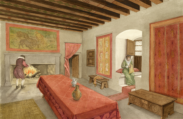 A large room with wooden beams and tapestries on the wall. There is a large fireplace at one end of the room and a long dining table in the middle. A lady sits in a window seat.