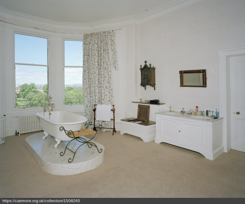 A bathroom in a house in Edinbugrh with a free-standing bath in front of a bay window
