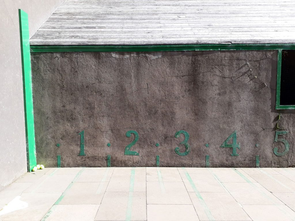 A wall with numbers spaced out at regular intervals.