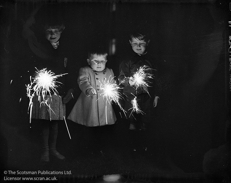 Archive image of young children holding sparklers
