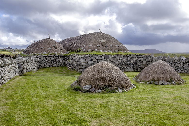 A thatched croft and outbuildings on the Isle of Lewis
