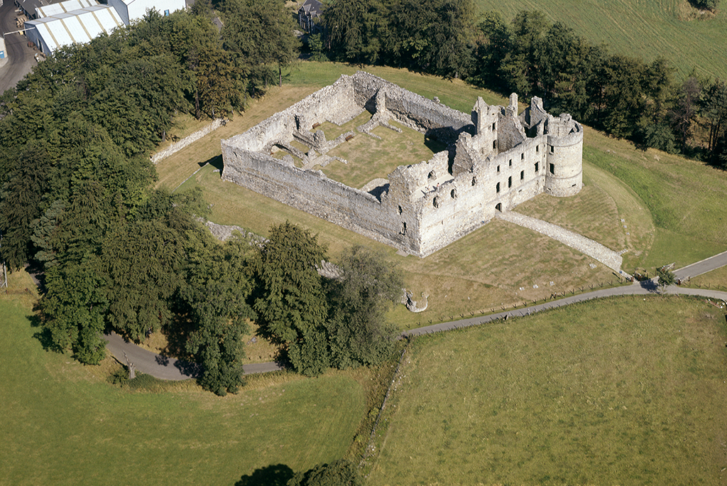 Aerial view of Balvenie Castle. It is enclosed i a large curtain wall.
