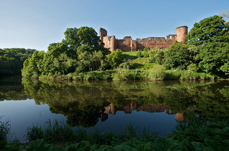 Bothwell Castle on a sunny day from across the River Clyde.