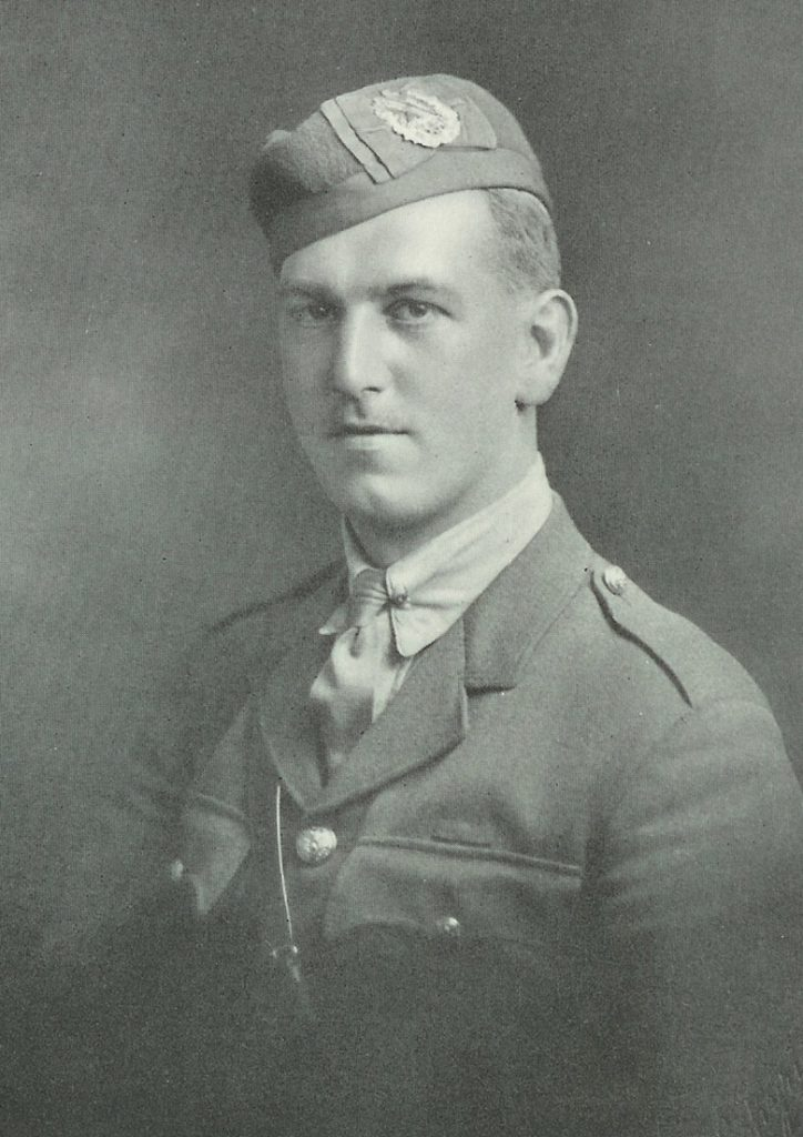 Head and shoulders portrait of a man in military uniform. He is clean-shaven.