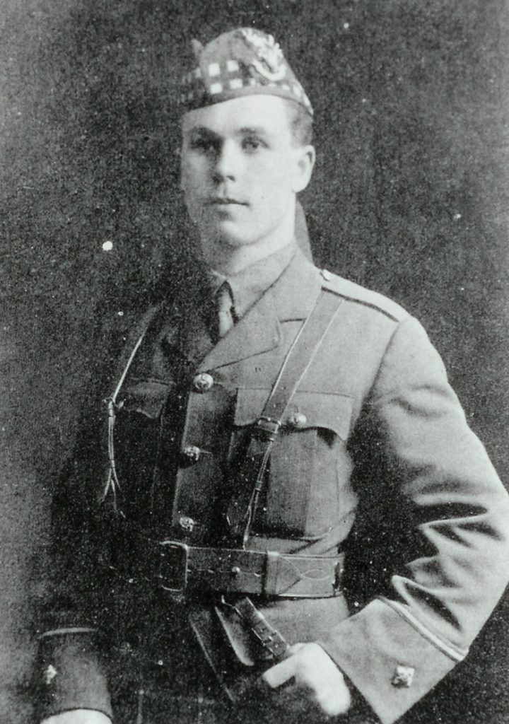 Half length portrait of a clean-shaven man in military uniform.