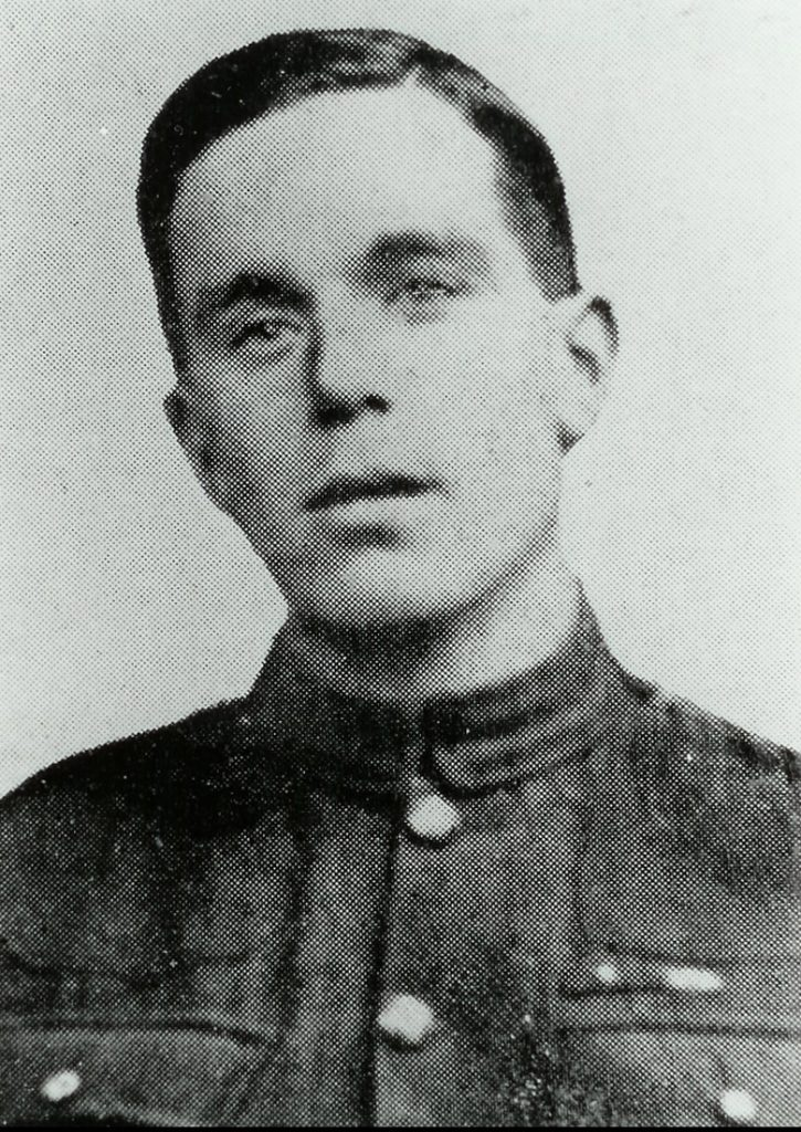 Head and shoulders portrait of a man in military uniform. He's clean-shaven and not wearing a hat.