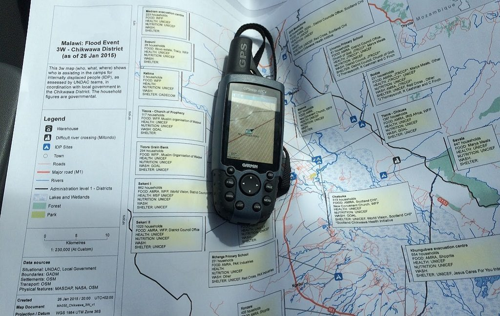 A GPS device laid on top of a printed map