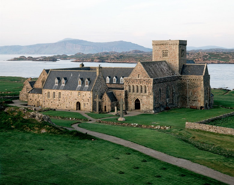 The extensive buildings of Iona Abbey with the sea and mountains in the background