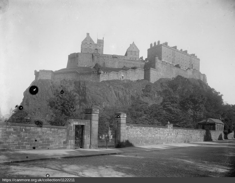 an archive image of Edinburgh Castle as viewed from King's Stables Road in 1920s.