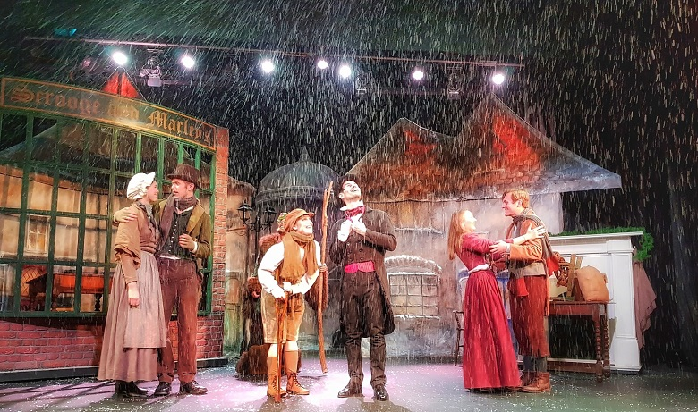Pantomime performers in a Victorian Christmas scene