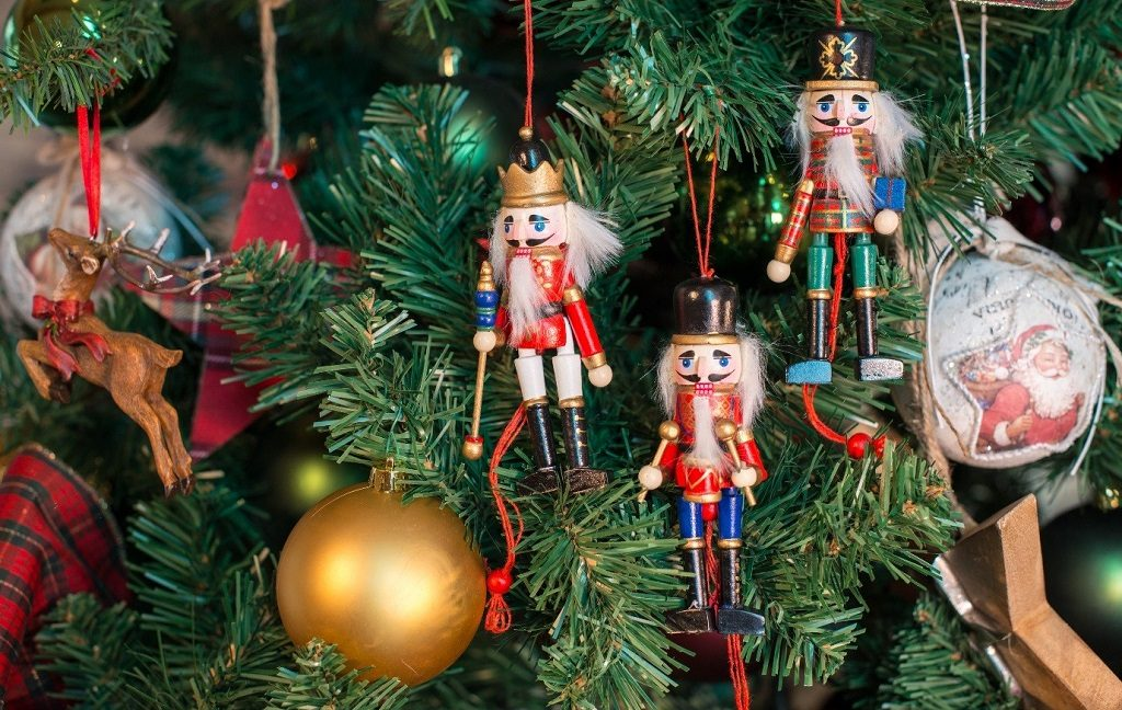 Festive decorations hanging from a tree