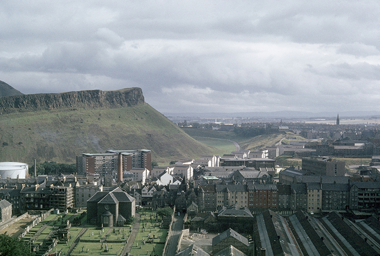 Elevated view of Edinburgh's Salisbury Crags with the Dumbiedykes area of the city in the foreground.