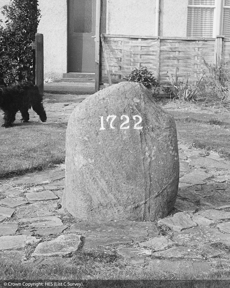 A modest, plain stone, maybe about 50cm in height, is marked with the date 1722.