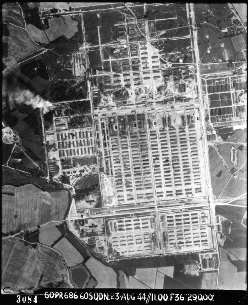 Aerial view of Auschwitz-Birkenau II. A massive complex of huts laid out in a grid format