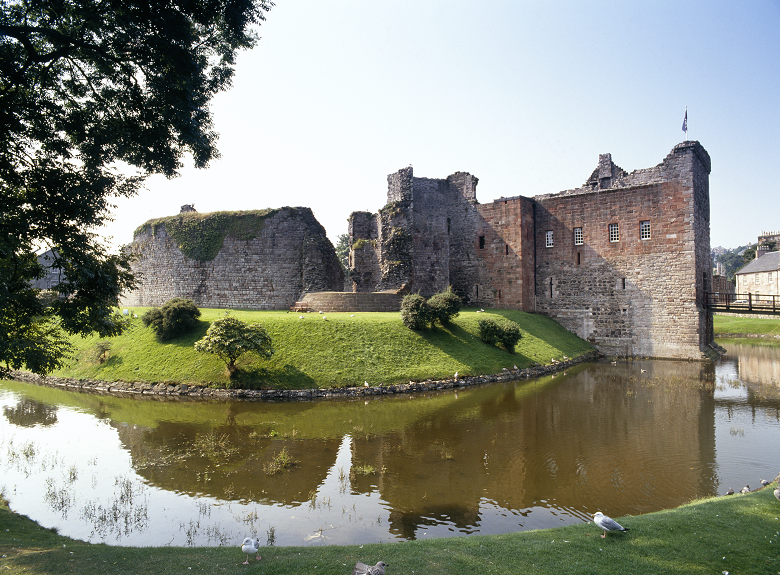 The ruins of Rothesay Castle, with its distinctive circular wall reflected in the moat