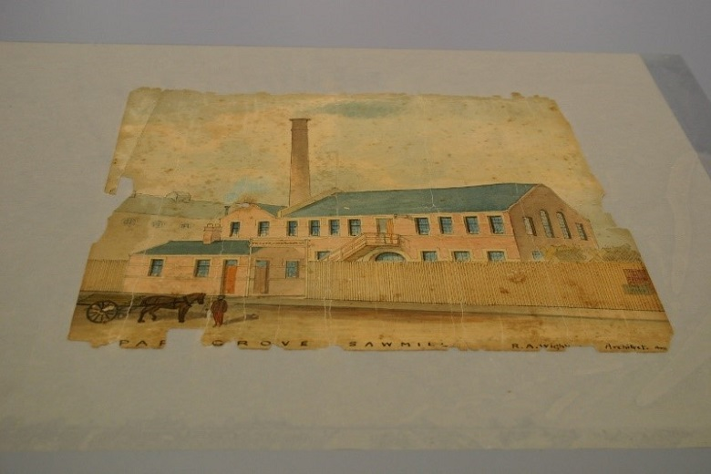 A damaged watercolour pieced back together after conservation treatment