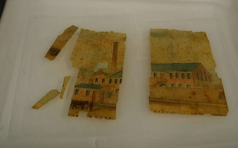 A damaged watercolour in several pieces is treated with water
