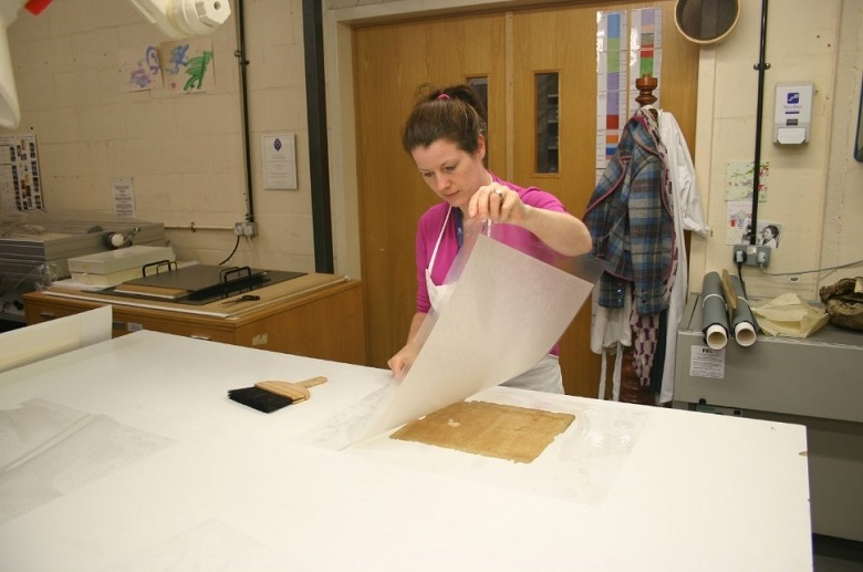 A paper conservator at work