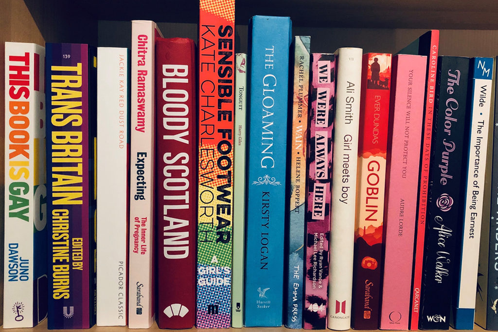 row of colourful books on a shelf