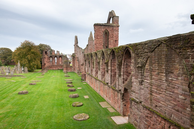 Ornate windows in a wall at the ruins of Arbroath Abbey