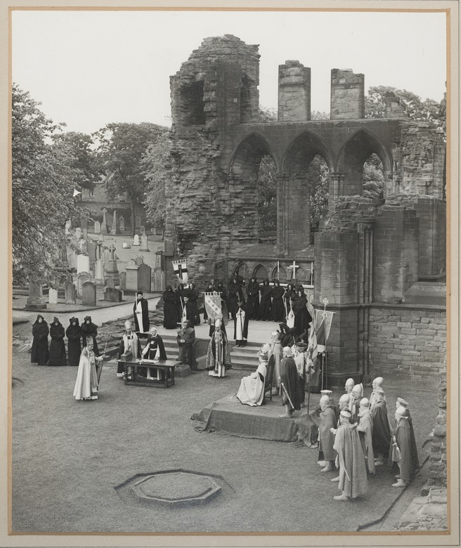 Archive photo of costumed reenactors recreating the signing of the Declaration of Arbroath within the ruins of Arbroath Abbey