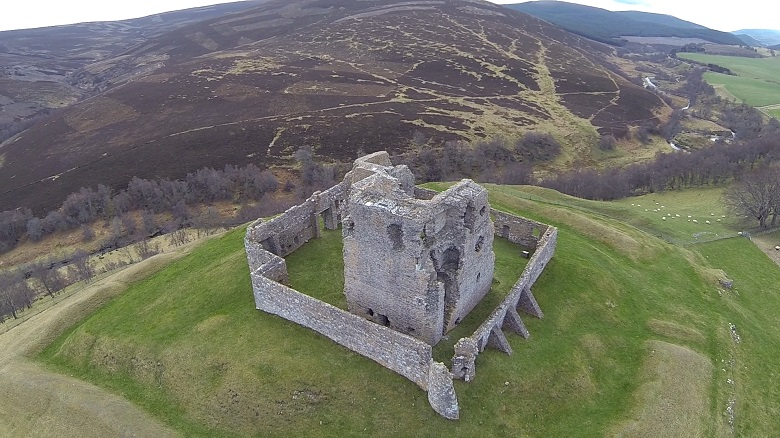 A drone photo showing Auchindoun Castle in its commanding hilltop location