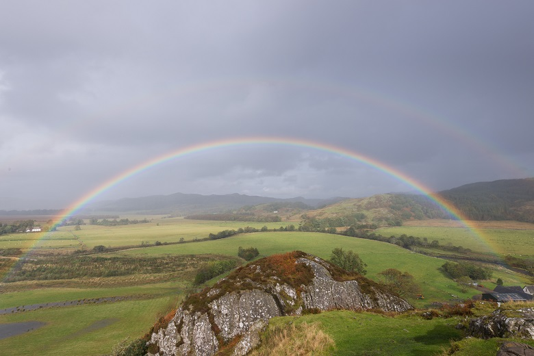 A rainbow across Kilmartin Glen captured from Dunadd Hill Fort